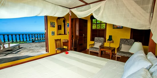A bedroom of this luxury property on Grenada with Caribbean Sea views