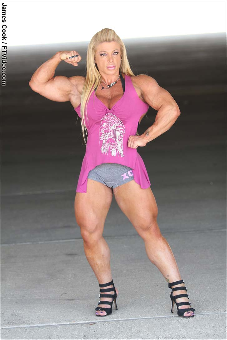 Anne Freitas Flexes Her Biceps And Muscular Legs