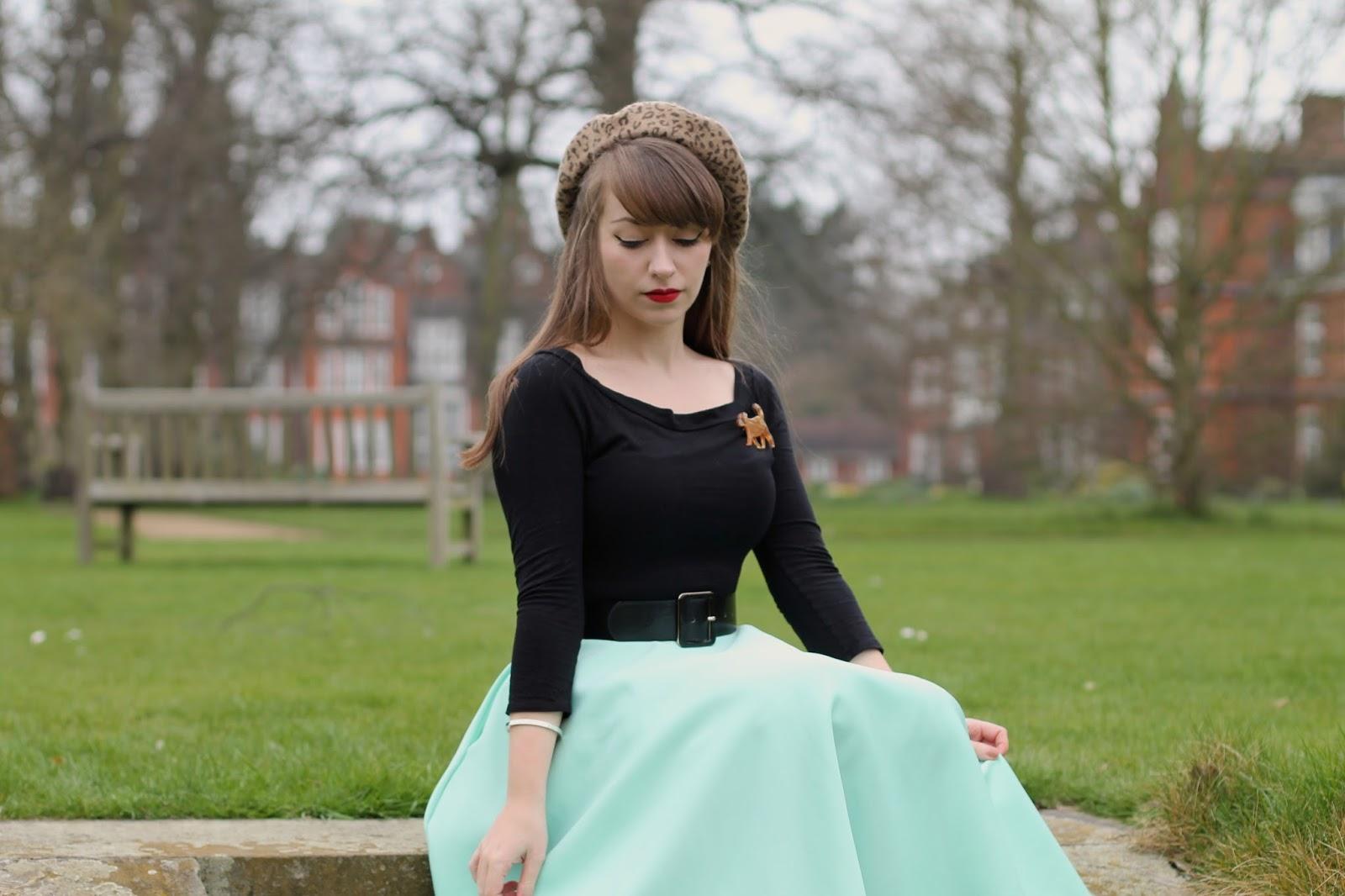 Mint green circle skirt, leopard print accessories and an Erstwilder dog brooch