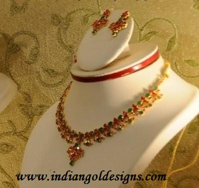 Gold and diamond jewellery designs emerald ruby necklace set for East indian jewelry online