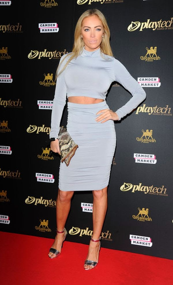 Aisleyne Horgan-Wallace wears a skin tight dress of light gray at the Playtech launch party in Gilgamesh, London on Tuesday, February 23, 2015.