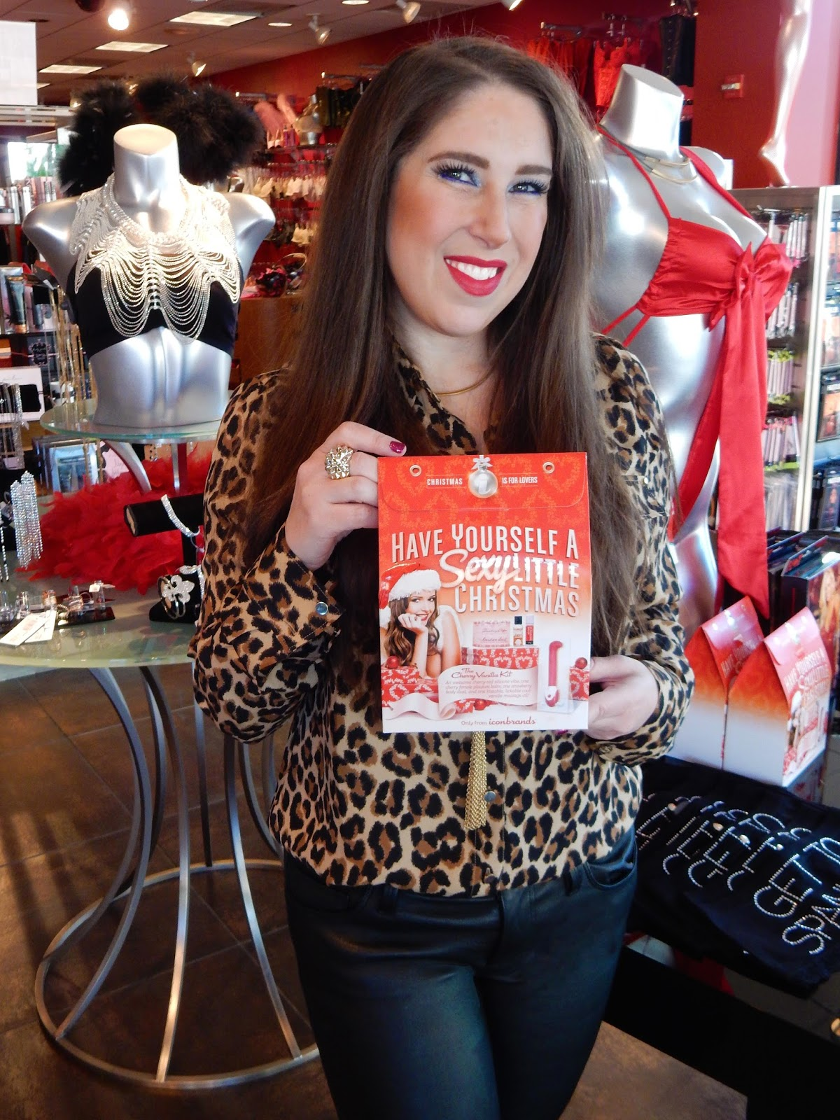 arisa The High Helled Brunette at Hustler Hollywood giving sexy christmas holiday gift ideas.