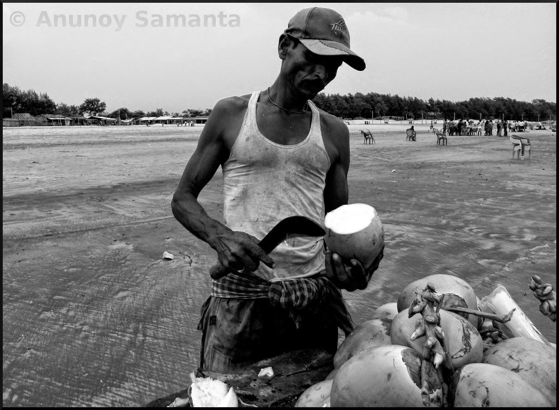 A Green Coconut Vendor over the Beach