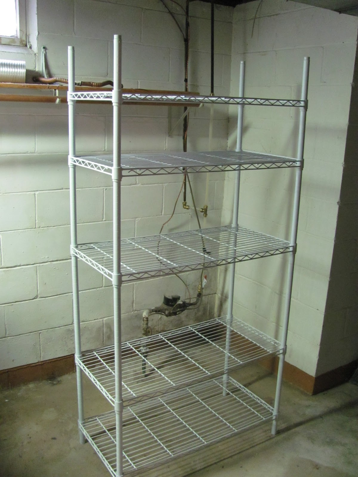Adjustable wire shelving unit on display in the basement before being sold on Craigslist