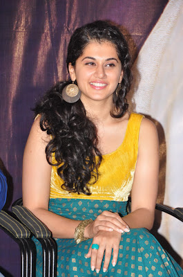 Tapsee yellow dress at press meet