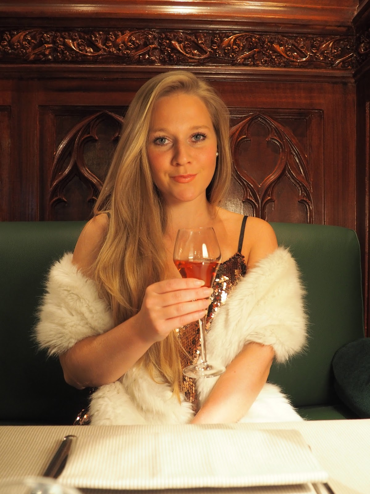 Blonde girl sipping champagne in The Dukes Bar, Hotel Westminster, Paris