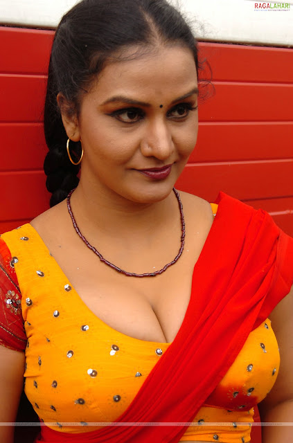 Apoorva aunty telugu movie photoshoot in red half saree boobs out ...
