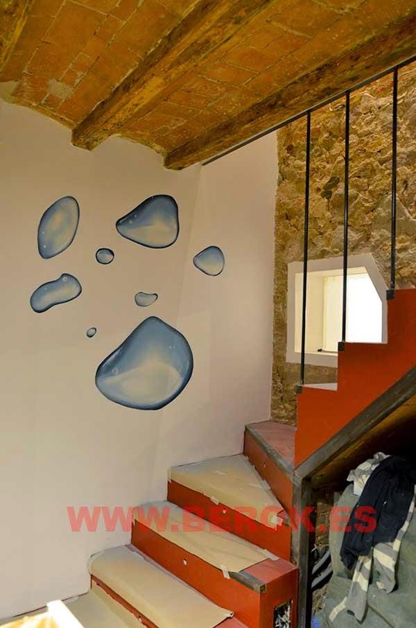 Graffitis de gotas de agua en escalera