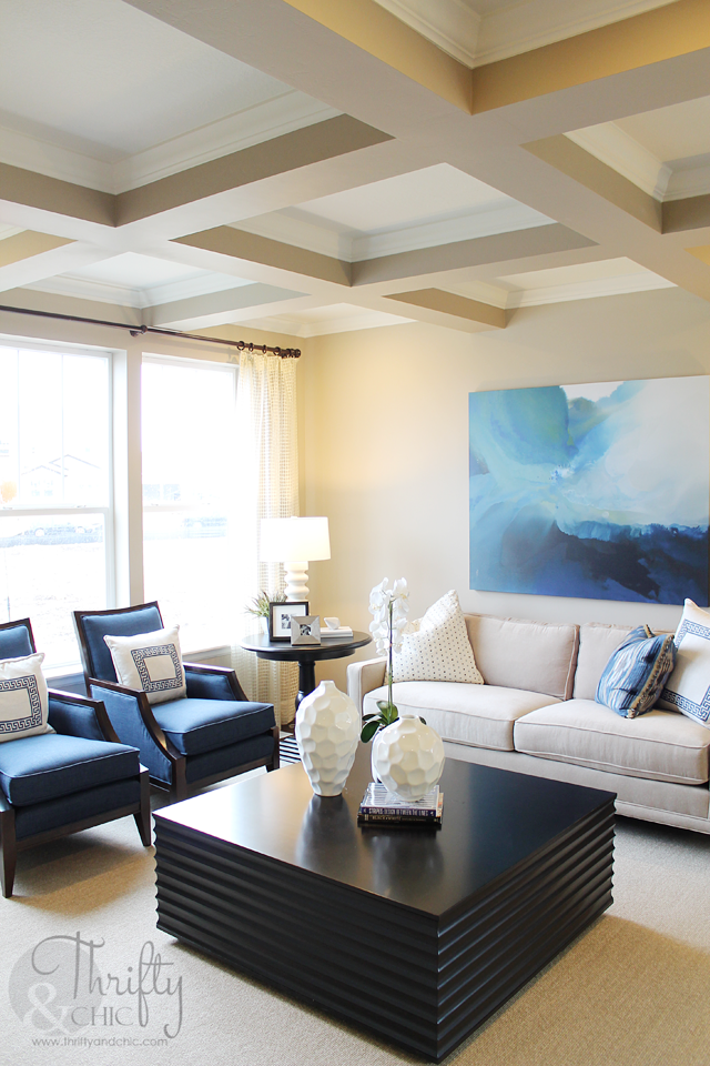 Blue/white/brown living room with coffered ceilings