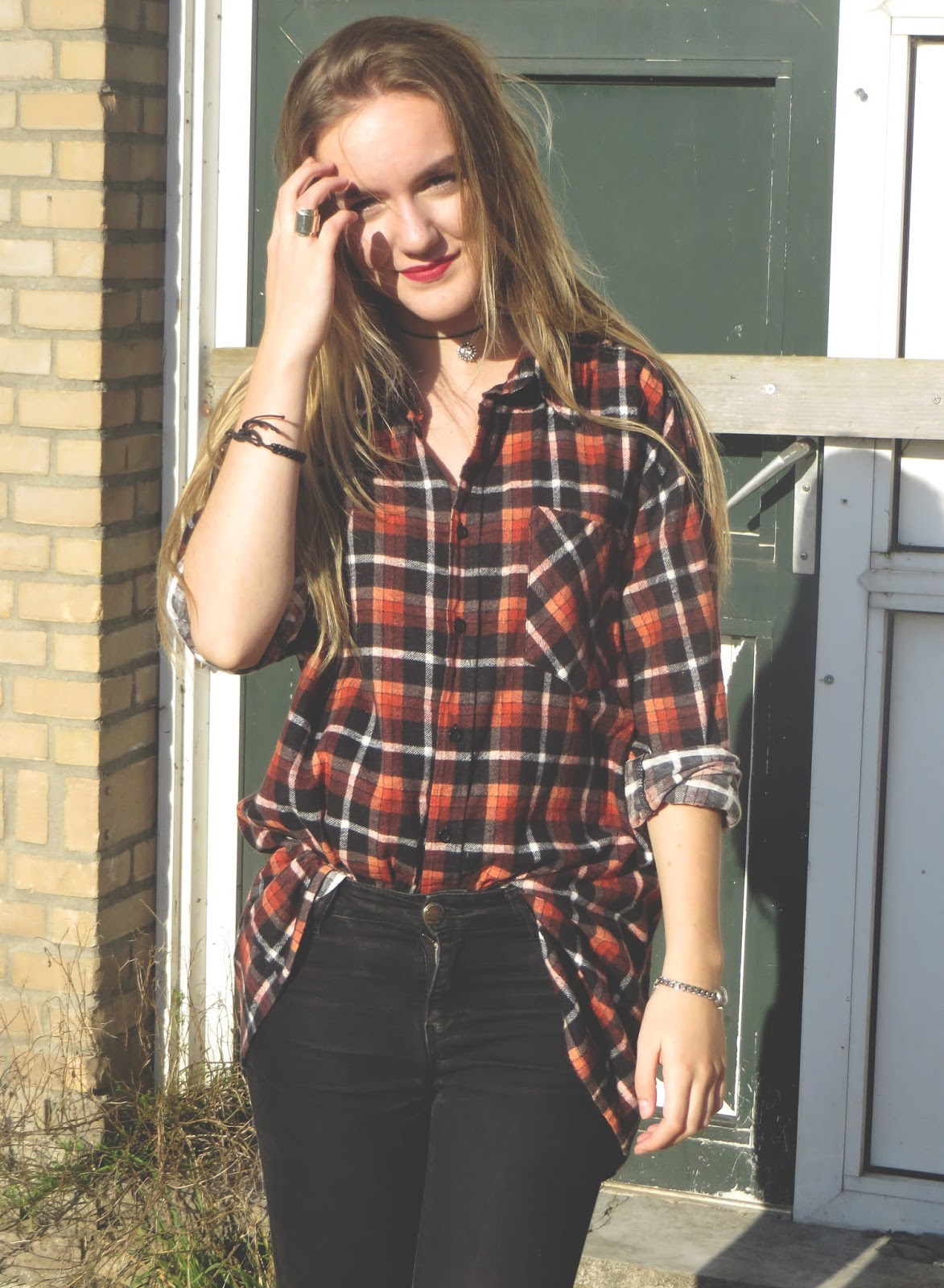 outfit with plaid or tartan shirt and black jeans