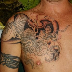 Amazing Dragon Tattoos On Chest For Men Inspiration