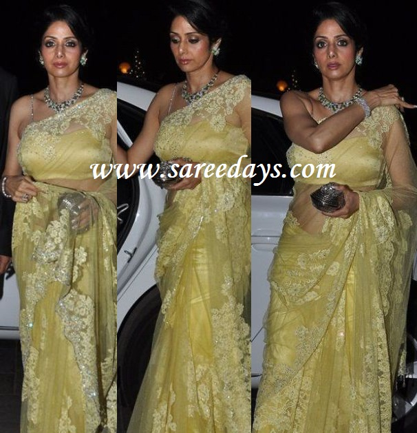 Latest saree designs sridevi in designer yellow net saree checkout actress sridevi in designer yellow net saree with lace work and paired with noodle strap designer blouse altavistaventures Images