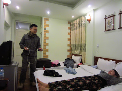 Two hostel guests relax in a hostel in Hanoi, Vietnam