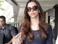 Deepika Padukone Spotted at airport in a transparent T-Shirt and Leather Boots