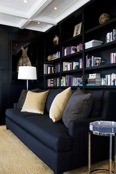 Home library with black built in book shelves