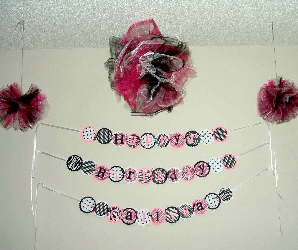 The Zebra Birthday Sign and Zebra Tulle Puffs.