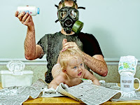 changing the baby while wearing a gas mask