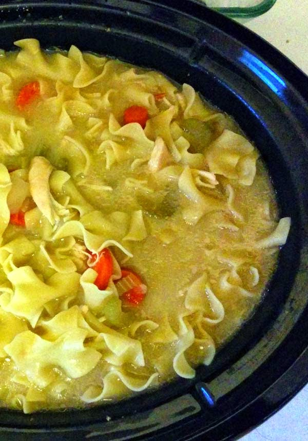 Slow Cooker Chicken Noodle Soup. This homemade recipes is creamy and simple. One of the easy comfort foods you can set-and-forget in the morning crockpot. Made with carrots, onions and celery. But you can add any other veggies to your liking. Try it with low carb noodles.