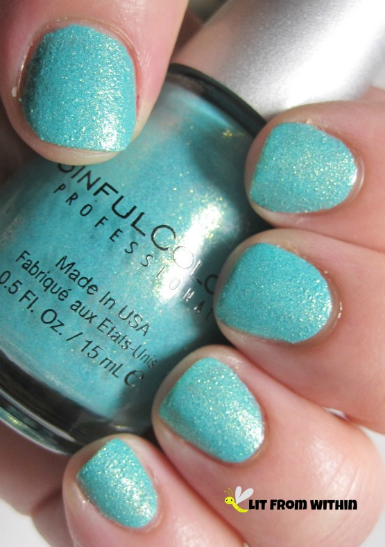 This lovely polish is Sinful Colors Crystal Crush Treasure Chest, a turquoise texture with a gold shimmer.