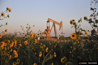 Devon Energy, owner of this pumpjack near Guthrie, Okla., is among those accused of negligence related to earthquakes. (Credit: Reuters) Click to Enlarge.