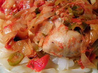 Closeup of Chicken with Green Garlic, Onion, and Tomato