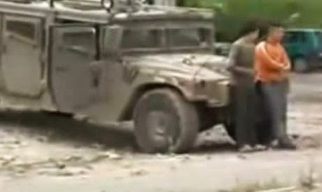 Palestinian children being used as human shields by the Israeli Army. (Screen capture  from YouTube video)