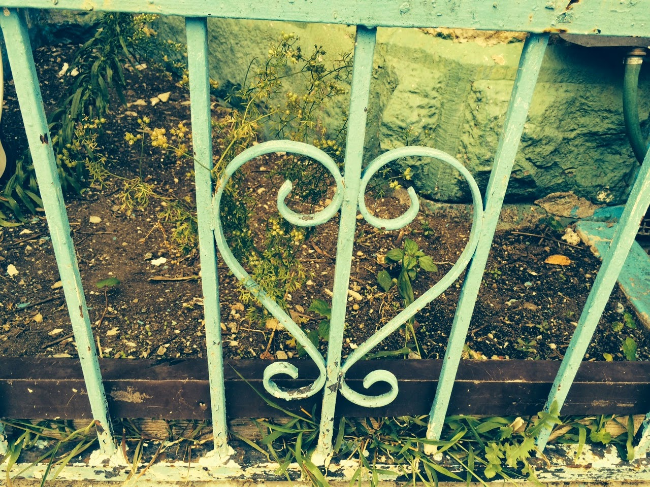 mint fence with a heart shape