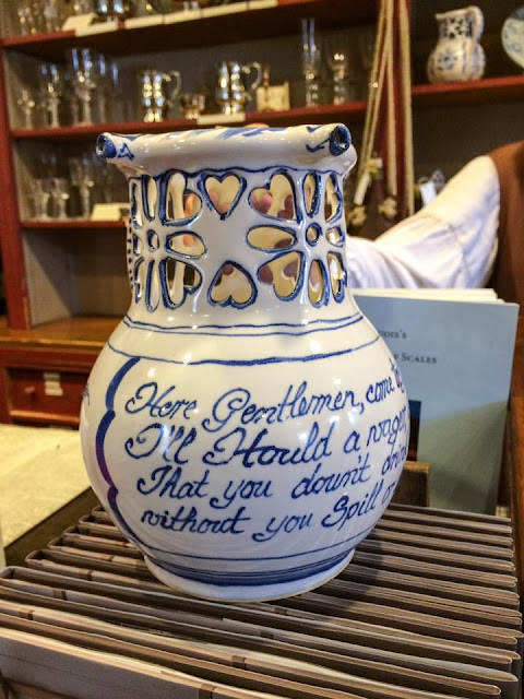 blue and white puzzle jug colonial williamsburg