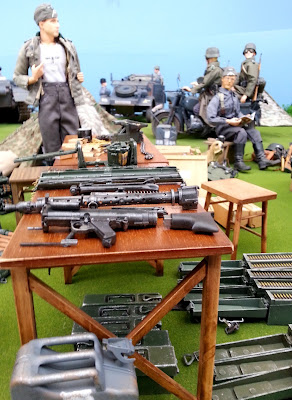 1/6 scale table of ammunition in diorama of an army post on display at a scale model exhibition.