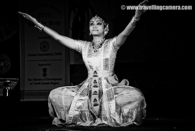 """Sattriya Dance Performance during Rongali Bihu Festival @ Indira Gandhi national Center of Arts (organized by Assam Association, Delhi on 24th April 2011) : Posted by VJ SHARMA on www.travellingcamera.com : Sattriya Dance performances is one of the main highlight of Rogali Bihu Festival at IGNCA, Delhi ! And this performance was full of expressions and it seems these songs were telling some story which dancer was enacting through her steps !!!  Let's have a look at some of the photographs from Sattriya performance on 24th April, 2011 with relevant information about this particular form of Indian Classical Dance !!!Sattriya Nritya is one among eight principal classical Indian dance traditions. Whereas some of the other traditions have been revived in the recent past, Sattriya has remained a living tradition since its creation by the Assamese Vaishnav saint Srimanta Sankardeva, in 15th century AssamSankardeva created Sattriya Nritya as an accompaniment to the Ankiya Naat (a form of Assamese one-act plays devisdby him), which were usually performed in the sattras, as Assam's monasteries are called. As the tradition developed and grew within the sattras, the dance form came to be called Sattriya Nritya.The name 'Sattriya' has been derived from the word 'Sattra' which are religious Institutes set up by the Vishnava Saint Shrimanta Shankardev for preserving and propagation of tradition, culture and religion. It was coined centuries after and represents all that the Saint had created, which brought about a Socio-cultural Renaissance in the Assam Valley of INDIA !!!The Sattra style was evolved when Shankaradeva, a great artist and musician in himself composed 'Ankiya Bhaona' or 'Ankiya-Nat' (dance-dramas), devotional music- 'Borgeet', and the four sacred texts - """"Kirtan', 'Dasam' 'Ghosa', 'Ratnavali' (the last two composed by Madhavdev). A School of Philosophical Learning emerged and a deeper understanding of life through the simple path of devotion brought one and all to t"""