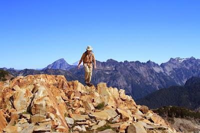 Reddish Rocks of Gothic Peak and Purple Backdrop