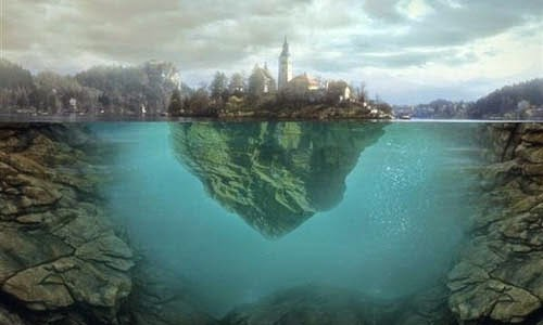 http://photoshoptutorials.ws/photoshop-tutorials/photo-manipulation/floating-island-on-water.html