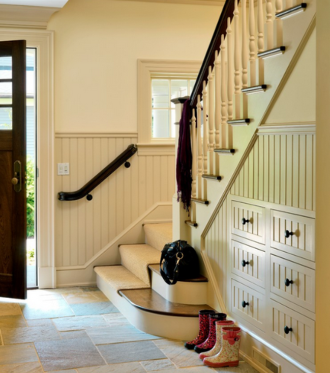 Under Stairway Walls Make An Excellent Place For Storing Shoes