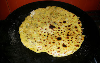 Flip The Roti And Apply Ghee Or Oil