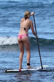 Ireland Baldwin wearing a pink thong bikini