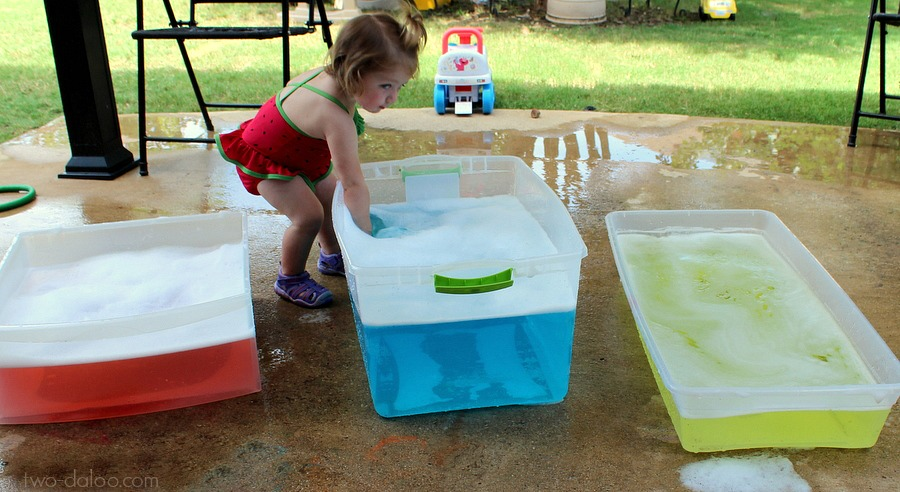 Colored Water Play tubs for toddler art exploration from Twodaloo