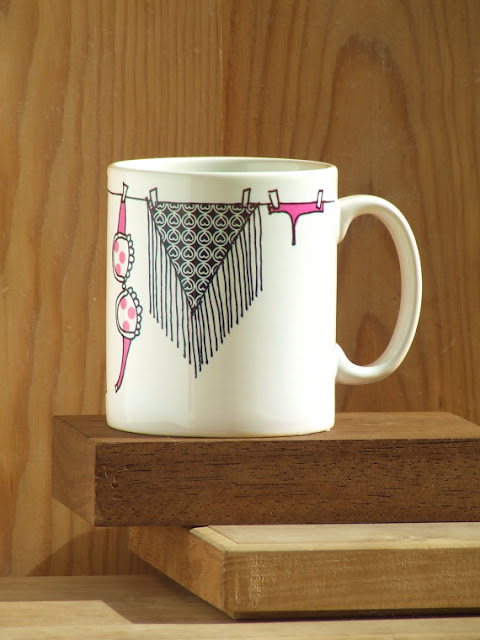 Funny and a bit naughty unique coffee mug design with clothesline of Alfama by Alfamarama