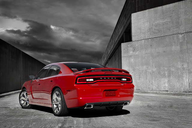 Rear 3/4 view of red 2011 Dodge Charger