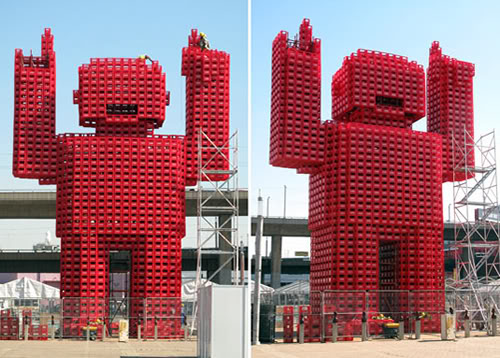 The Red giant sculpture made of 2500 attire Coco-cola plank box.