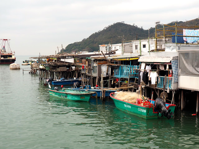 Fishing boats and stilt houses on the water in Tai O village, Lantau Island, Hong Kong