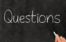 picture of a chalk board that says questions