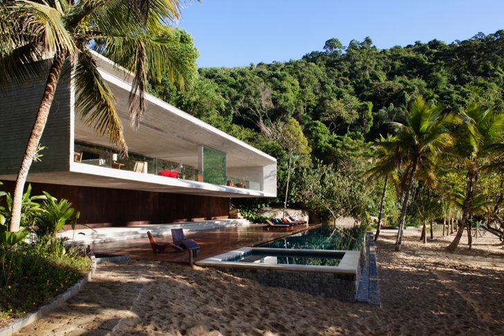 Modern beach house in Brazil by Marcio Kogan on the beach