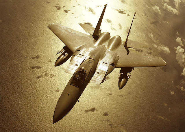 F-15C over the pacific in golden glow.
