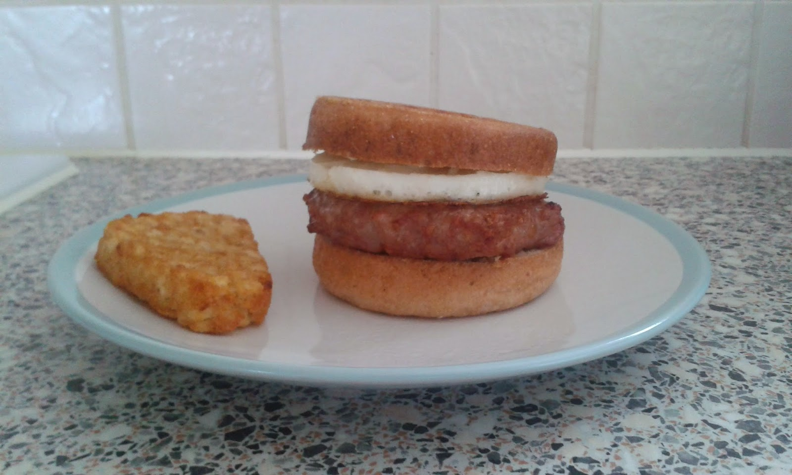 A gluten free sausage and egg breakfast muffin and hash brown on the side. Next time I'll be adding a slice of cheese too