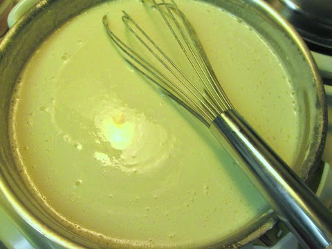 Add the cheeses in batches, making sure to whisk constantly so it doesn't burn