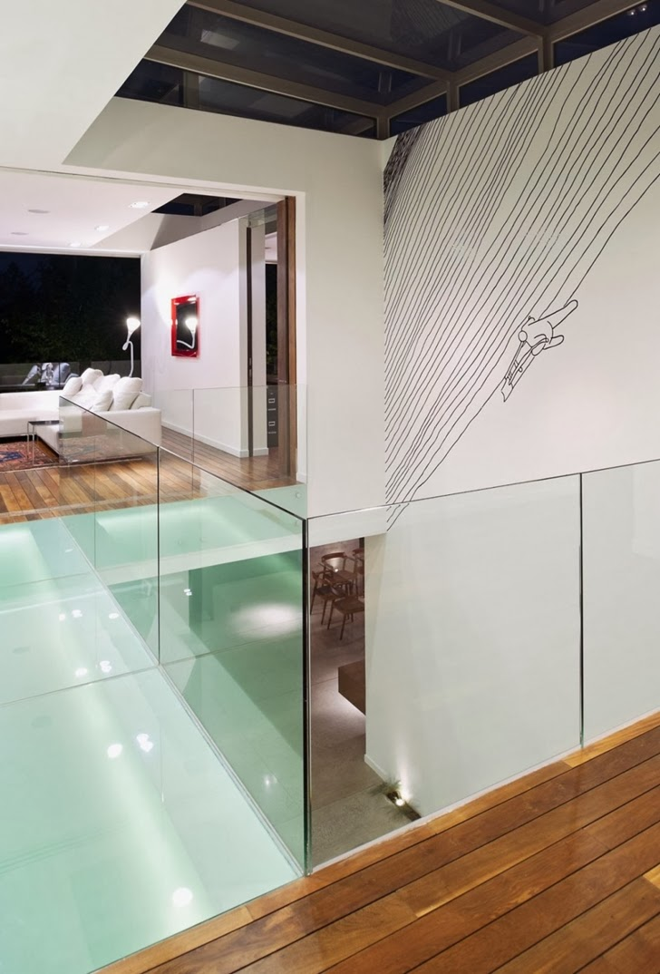 Glass railing in Modern dream home by Paz Arquitectura