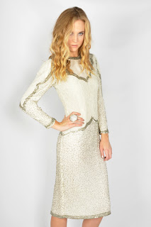 Vintage 1980's white silk dress with silver beading and long sleeves.