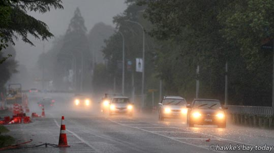 Cars with lights on at 5pm, heavy rain, storm, thunder, weather, Havelock Rd, Havelock North. photograph