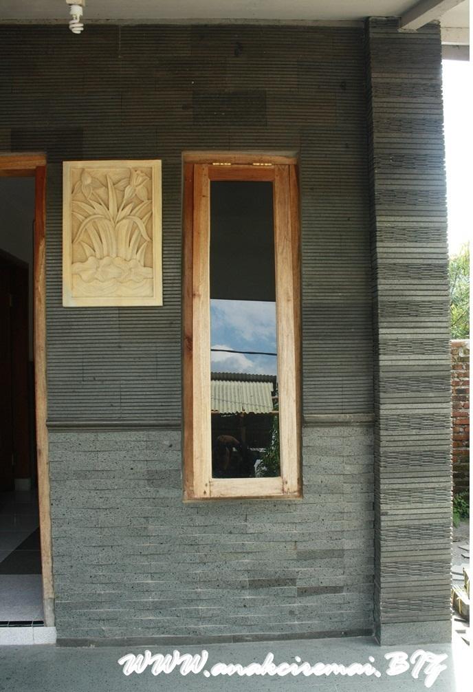 contoh pemasangan batu alam pada dinding rumah