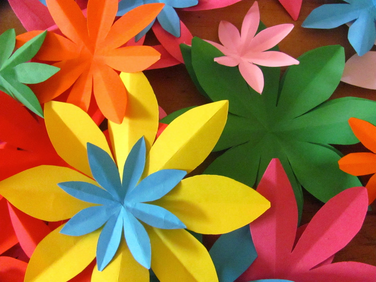 Make your own zoo easy paper flowers more flowers made from paper this time and really quick to do good cutting practice for kids too and its fun opening up your folded snipped piece of mightylinksfo